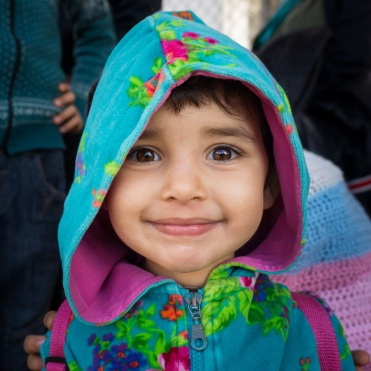 An Afghan girl waits with her parents and four siblings to register with Greek authorities in the Moria registration camp on Lesvos. November 2015.