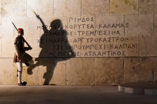 "An ""Evzone"" soldier guards the Tomb of the Unknown Soldier and Greek Parliament in Syntagma Square, Athens. October 2015."