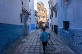 "A boy runs through the quiet streets of Chefchaouan the ""Blue City"" in northern Morocco. October 2015."